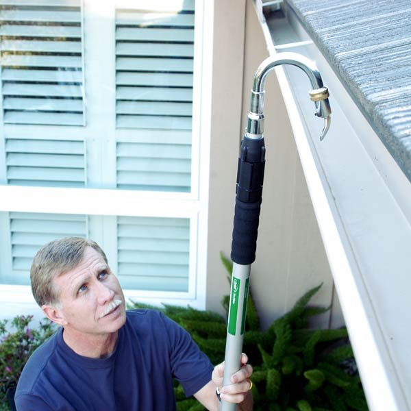 man cleaning his gutter